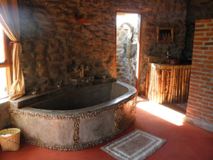 Giant tub in Puziko guest room with elephant shower outside